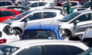 customers tour a car showroom