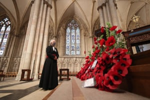 The Rev Maggie McLean, York Minster's canon missioner, observes a two-minute silence in the cathedral