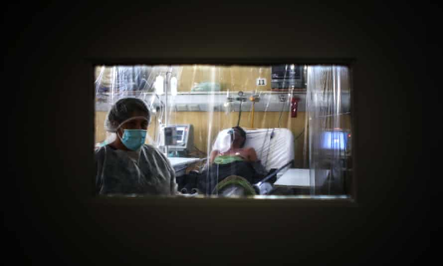A healthcare worker and patient at an intensive care unit in Buenos Aires.
