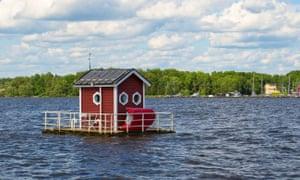 Floating cabin on a lake, entrance to The Utter Inn, at malaren Vasteras Sweden