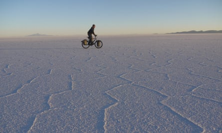 Stephen Fabes on his bicycle crossing a salt plain.