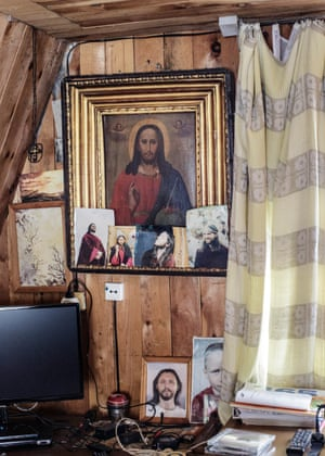 Photographs of Vissarion adorn a painting of the biblical Jesus