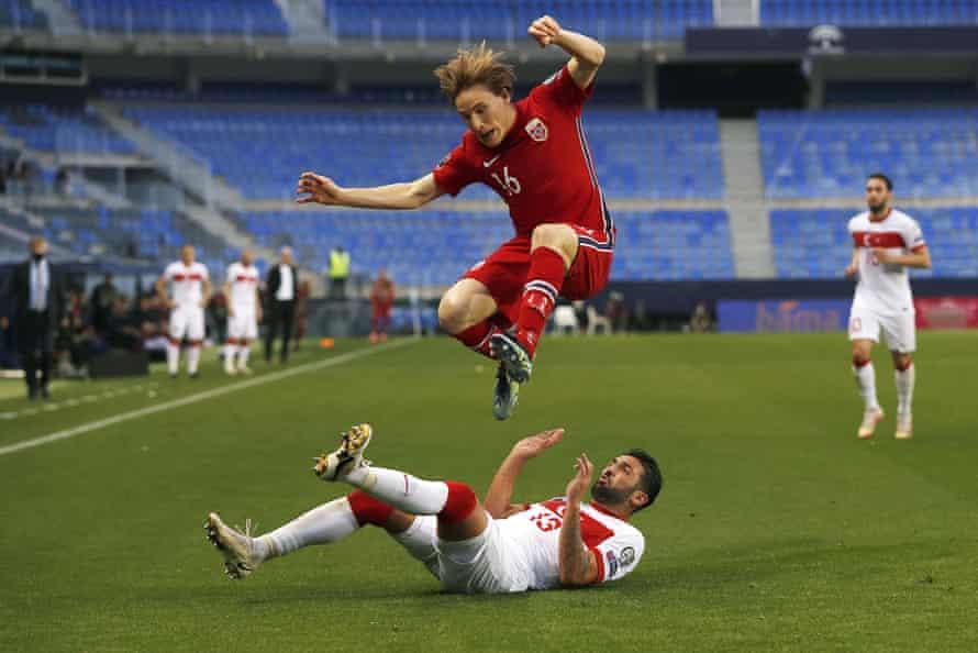 Turkey's Umut Meras challenges Norway's Jonas Svensson for the ball.
