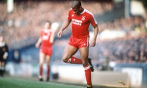 Liverpool's John Barnes backheels off the pitch a banana thrown from the crowd during a Merseyside derby at Goodison Park in 1988.