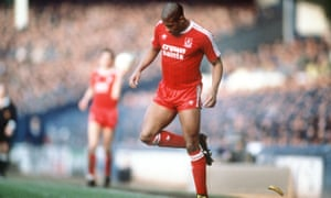 Liverpool's John Barnes backheels a banana thrown onto the pitch during an FA Cup tie against Everton in February 1988.