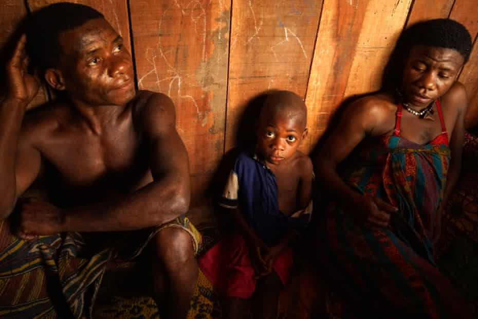In Yandoumbe village, pygmies Malala, left, and her 20-something daughter Agate, right