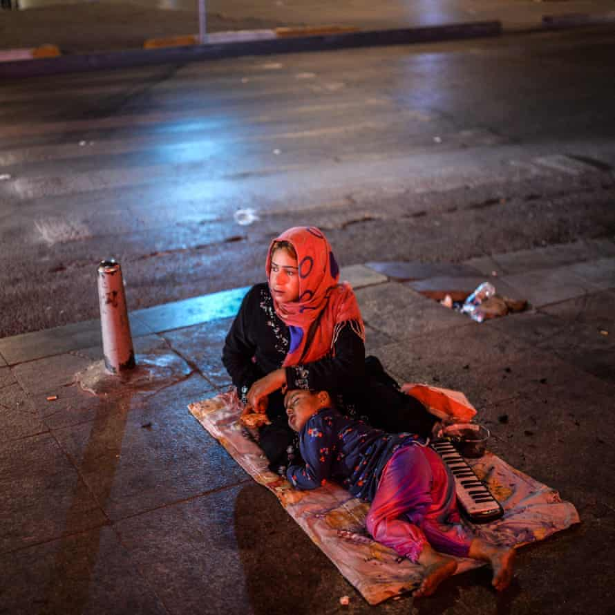 A Syrian refugee and a child sleeping rough on Taksim Square, Istanbul, in 2015.