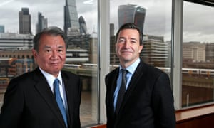 Nikkei Chairman Tsuneo Kita and Financial Times CEO John Ridding pose for a photo at the Financial Times headquarters in London.