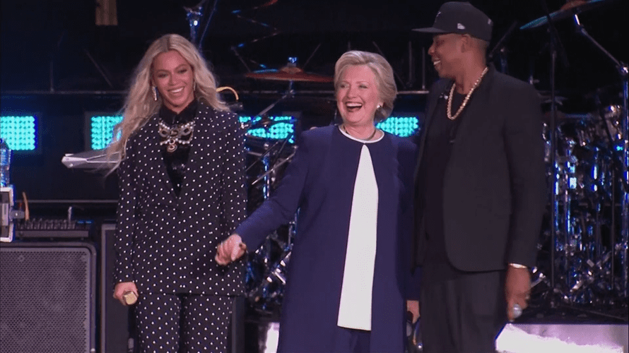 Beyoncé and Jay Z pledge their support for Hillary Clinton at a concert in Cleveland.