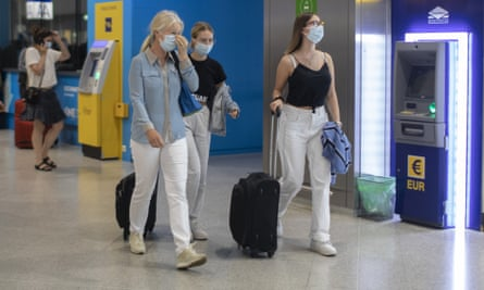 Tourists from the UK arriving at Athens International airport after flight restrictions were lifted by Greece.