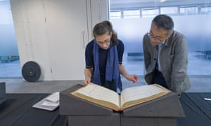 Dr Juliette Desplat looking at the British copy of the treaty of Versailles