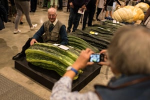 Grower Peter Glazebrook poses for a photograph with his marrow, weighing 65.3kg