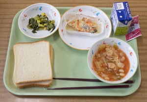 Lunch served to 11-year-olds at Konan primary school: bok choy and sautéed sweet corn, baked cod, minestrone soup, milk, white bread and soy-based chocolate spread.