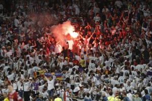 The Real Madrid fans celebrate Bales super strike.