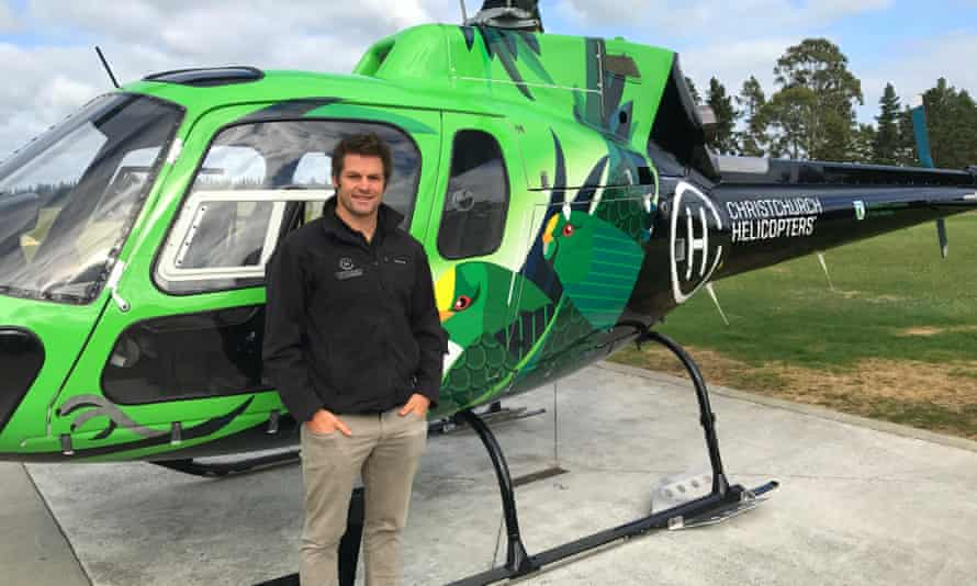 Former All Blacks captain Richie McCaw with his Kākāriki-themed Christchurch helicopter.