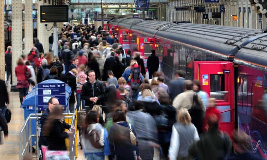 Commuters at London Paddington station