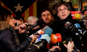 Carles Puigdemont, right, talks to the press in Leuven, Belgium, on 6 February – 100 days into his self-imposed exile.