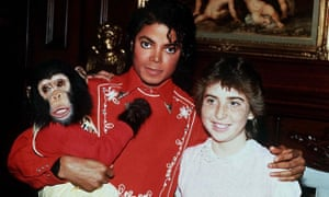 Michael Jackson and his chimp Bubbles meet a teenage fan in 1994.