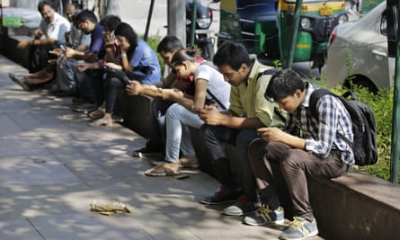 Indians use their mobile phones in New Delhi
