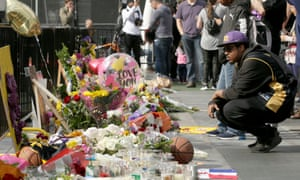 People gather at a memorial for Kobe Bryant, across the street from Staples Center, in Los Angeles, California, 27 January 2020.