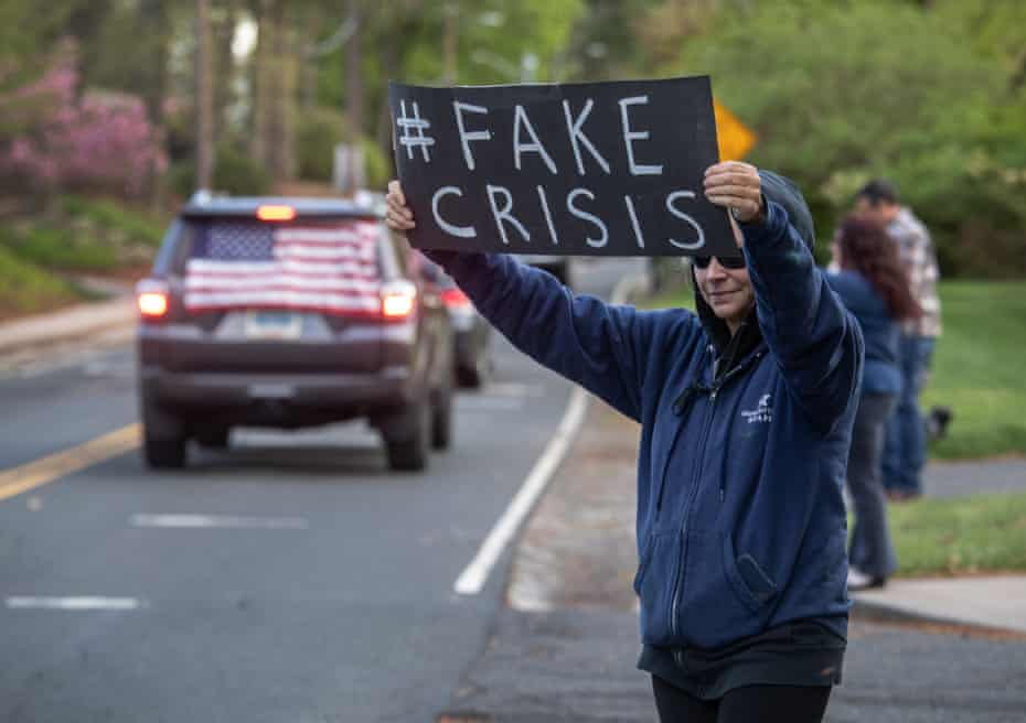 Demonstrators hold a 'Rolling Car Rally' in front of Connecticut governor Ned Lamont's home in Hartford.