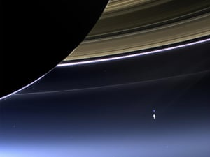 19 July 2013 In this rare image, Cassini has captured Saturn's rings and Earth in the same frame. Earth is 898 million miles (1.44 billion kilometers) away in this image and appears as a blue dot; the moon can be seen as a fainter protrusion off its right side. This was only the third time ever that Earth has been imaged from the outer solar system. It was the first time that people on Earth knew in advance that their planet was being imaged, allowing people around the world to join together in social events to celebrate the occasion
