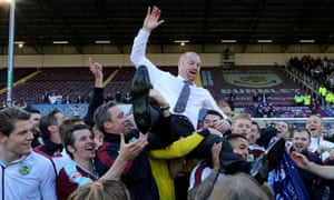 Sean Dyche is thrown into the air by his jubilant Burnley players