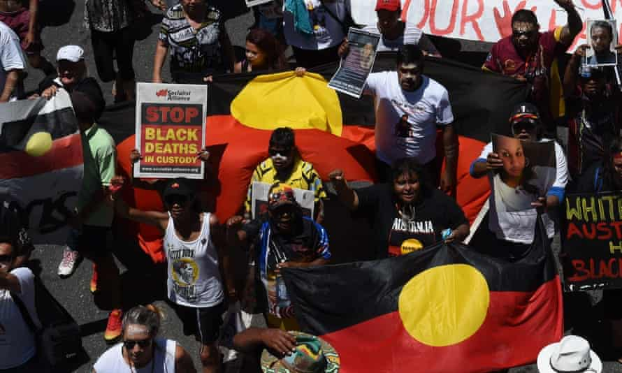 Indigenous rights campaigners protest in Brisbane about Indigenous deaths in custody.