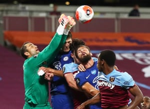 West Ham keeper Lukasz Fabianski beats Chelsea's Olivier Giroud to the ball and punches clear.