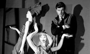 Hubert de Givenchy poses with mannequins in his shop in Paris, 1952