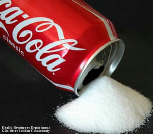 An advert picturing sugar pouring from a can of Coca-Cola.