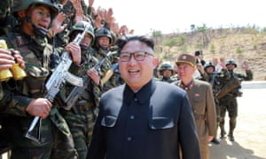 North Korean leader Kim Jong-un inspects his troops at an undisclosed location.