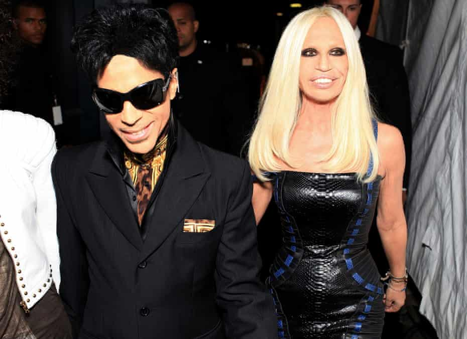 Versace with Prince at the at the launch of the H&M range in 2011.