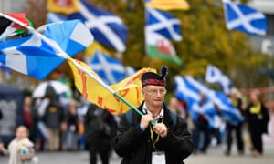 Independence supporters hold a rally outside the Scottish National party conference.