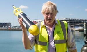 Boris Johnson holding a miniature autonomous submarine at the National Oceanography Centre in Southampton
