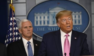 US president Donald Trump flanked by vice-president Mike Pence at the White House briefing.