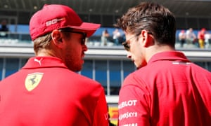 Ferrari's Sebastian Vettel (left) and Charles Leclerc in discussion at Sochi where the German driver ignored team orders with costly results.