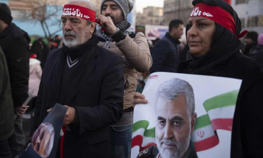 Mourners in Tehran attend a funeral ceremony for Qassem Suleimani.