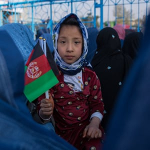 Basira, 5, sits among her relatives at Mazar-e-Sharif's Blue Mosque, celebrating the New Year.