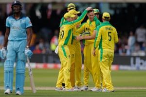 Australia players congratulate Jason Behrendorff as England's Jofra Archer walks off after his dismissal.