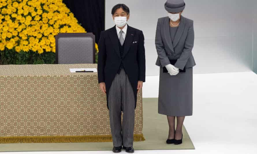 Japan's Emperor Naruhito and Empress Masako attend the memorial service with about 500 participants, reduced from 6,200 last year, who mourned the dead with a minute of silence.