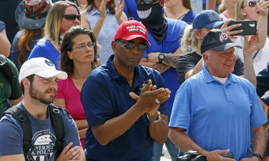 """Burgess Owens, center, looks on during a """"Blue Rally"""" to support law enforcement"""