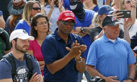 "Burgess Owens, center, looks on during a ""Blue Rally"" to support law enforcement"