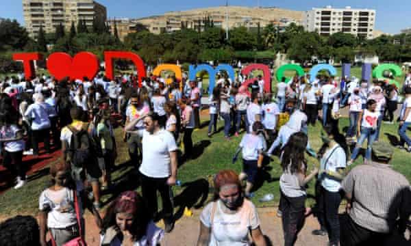 People during an 'I Love Damascus' marathon in Umayyad Square, Damascus