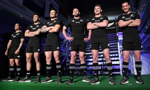 New Zealand players pose during the unveiling of the team's new jersey in Tokyo.