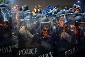 Bangkok, ThailandRiot police hold onto their shields as pro-democracy protesters take part in an anti-government demonstration.