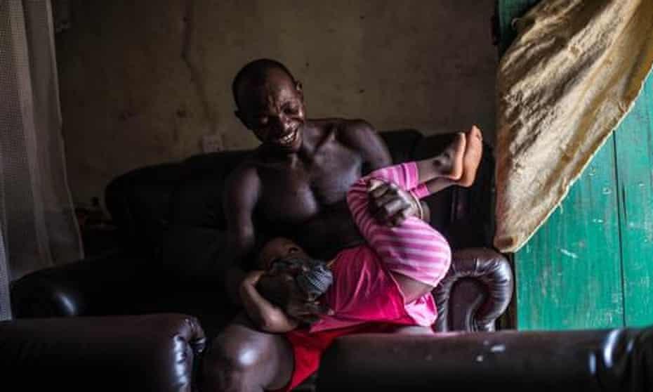 Ebola survivor Demba Mansaray with his daughter