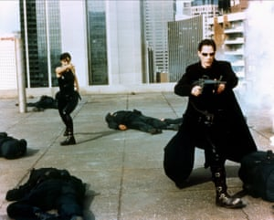 Carrie-Ann Moss and Keanu Reeves in The Matrix: dutifully validating his masculine empowerment