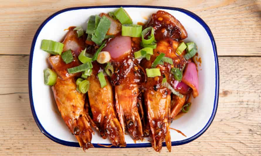 'Brilliant crimson with a sweet-sour sauce in even deeper red': devilled prawns.