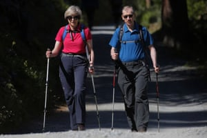 Theresa May walks in a forest with her husband Philip at the start of a summer holiday in the Alps.